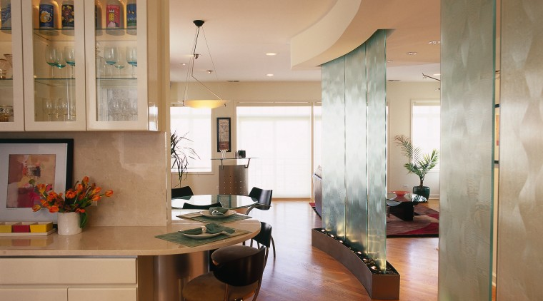 Glass in the partitions is echoed in the ceiling, countertop, floor, flooring, interior design, kitchen, living room, real estate, room, brown