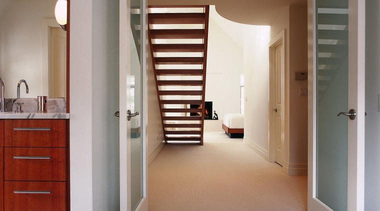 Open stairs allow an uninterrupted view between bedroom door, floor, flooring, hardwood, home, interior design, real estate, room, wall, window, wood, wood flooring, gray