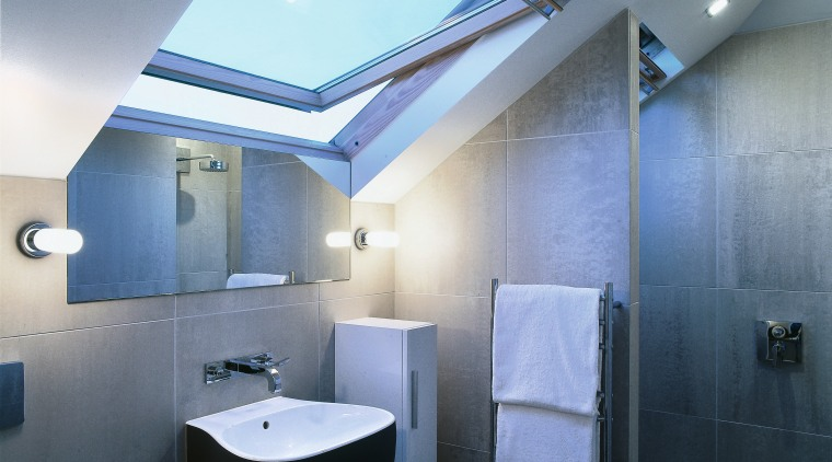 Tiled surfaces create a clean, modern look. architecture, bathroom, ceiling, daylighting, interior design, lighting, product design, room, teal