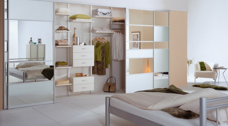 A view of the wardobe storage system in bed frame, furniture, interior design, gray, white