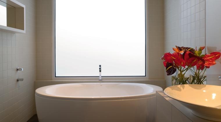 The bathroom has a streamlined and contemporary look, bathroom, bathroom accessory, interior design, plumbing fixture, room, sink, toilet seat, window, gray
