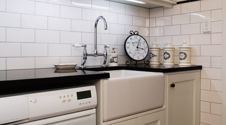 The butler's sink and chrome brass taps are cabinetry, countertop, cuisine classique, floor, flooring, home appliance, interior design, kitchen, kitchen stove, major appliance, room, sink, tile, gray