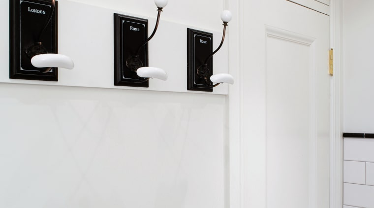 Coat hangers along one side are colour matched bathroom accessory, furniture, interior design, product, product design, room, shelf, tap, white