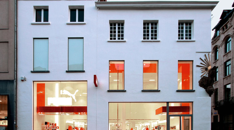 An exterior viow of the puma shopfront,  architecture, building, facade, house, window, teal