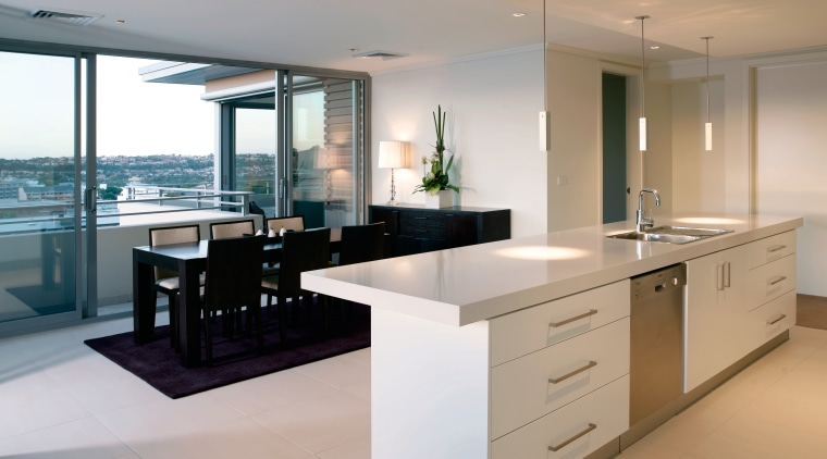An interior view of the Kitchen and dining cabinetry, countertop, floor, interior design, kitchen, property, real estate, gray