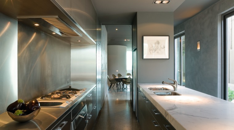 A view of this kitchen featuring polished concrete architecture, ceiling, countertop, interior design, kitchen, room, gray, brown