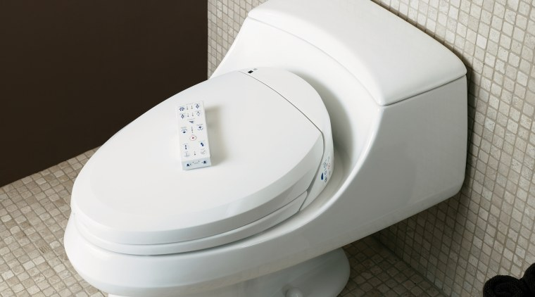 The Kohler C toliet seat offers a choice bidet, hardware, plumbing fixture, product, product design, toilet, toilet seat, white, black, gray