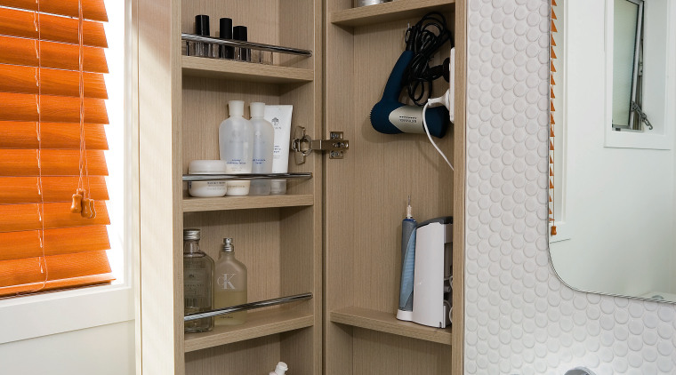 A view of a bathroom designed by Yellowfox. bathroom, bathroom accessory, bathroom cabinet, bookcase, cabinetry, furniture, interior design, product design, room, shelf, shelving, gray, brown