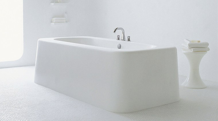 A view of this white bathroom featuring bathtub, bathroom sink, bathtub, bidet, ceramic, plumbing fixture, product design, sink, tap, white