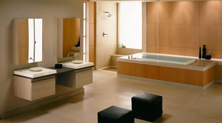 A view of this bathroom featuring tiled flooring, bathroom, floor, flooring, furniture, interior design, plumbing fixture, room, sink, tile, wood flooring, brown