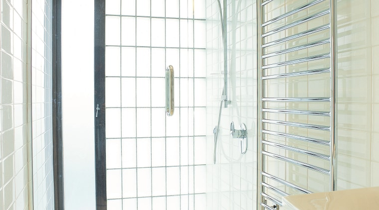 A view of a glass shower enclosure by bathroom, curtain, door, glass, interior design, plumbing fixture, room, shower, tile, window, window covering, window treatment, white