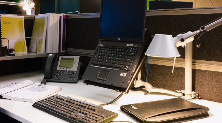 A view of this desk featuring laptop, phone, desktop computer, electronic device, furniture, laptop, netbook, personal computer, product, product design, technology, black