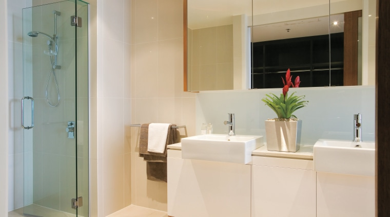 A view of the bathroom featuring tiled walls/flooring, bathroom, bathroom accessory, floor, home, interior design, room, gray