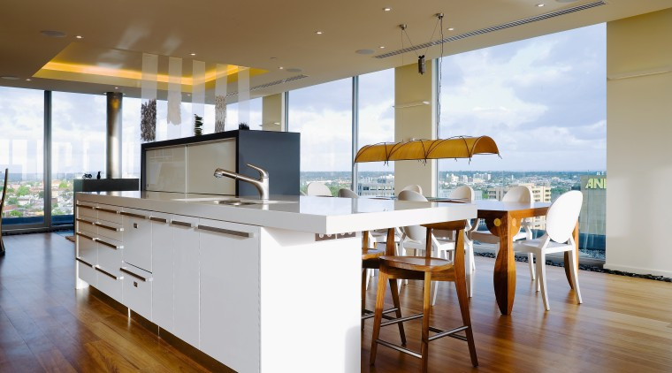 Minimalist, but not sterile, the kitchen allows the architecture, countertop, floor, flooring, hardwood, house, interior design, kitchen, real estate, wood flooring, brown, white
