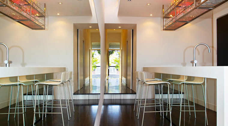 Recycled materials were used extensivley throughtout the home.The ceiling, daylighting, floor, flooring, house, interior design, table, wood, black, gray