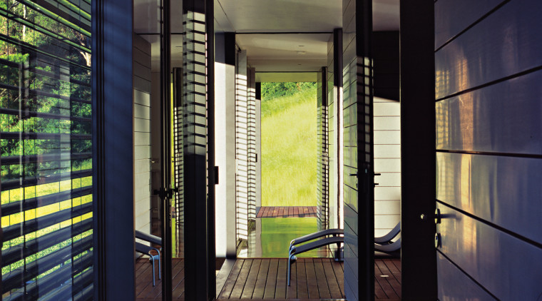 A view of the hallway featuring polished recycled architecture, door, glass, house, interior design, window, black, blue