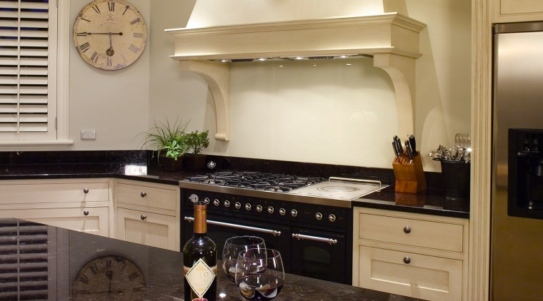 A view of this traditional kitchen featuring antique countertop, interior design, kitchen, living room, room, orange, black