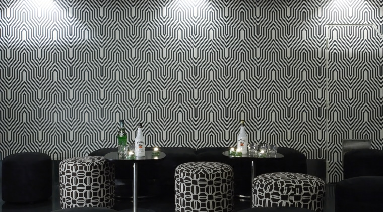 Geometric print wallpaper and fabric covering for the architecture, ceiling, daylighting, interior design, light, light fixture, lighting, product design, table, wall, gray, black