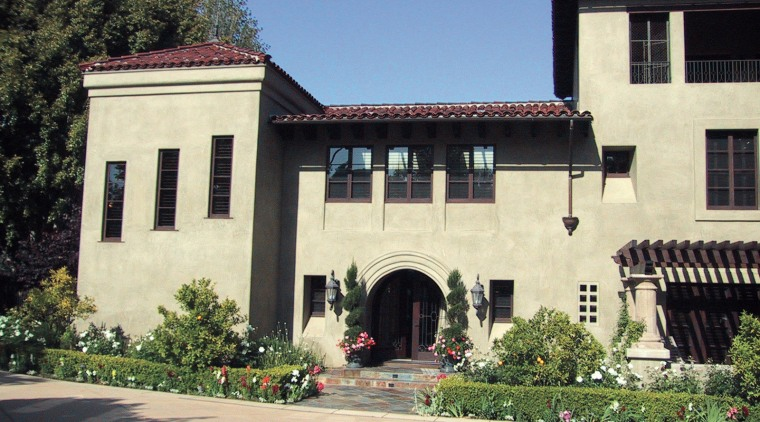 This spanish-style residence was transformed by the Landry building, estate, facade, home, house, mansion, tree, window, black