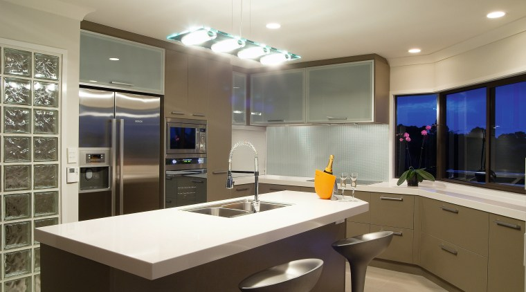 A view of this modern contemporary designed kitchens cabinetry, countertop, interior design, kitchen, real estate, room, gray