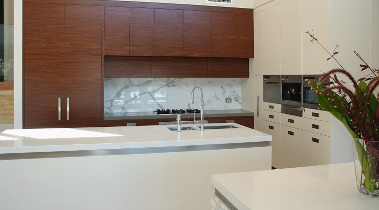 The island in this kitchen have benchtops of cabinetry, countertop, interior design, kitchen, gray