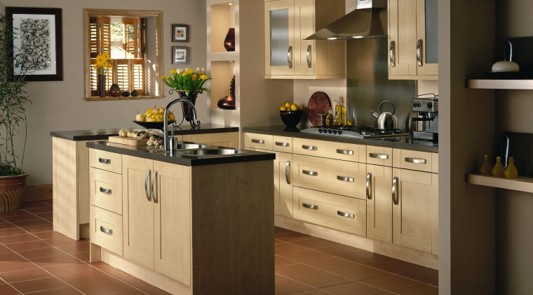 A view of some kitchen ware from Kitchen cabinetry, countertop, cuisine classique, floor, flooring, hardwood, interior design, kitchen, laminate flooring, room, tile, wood flooring, brown