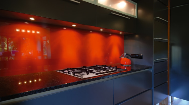 A view of this kitchen featuring AEG 5 countertop, interior design, kitchen, lighting, room, under cabinet lighting, black, red