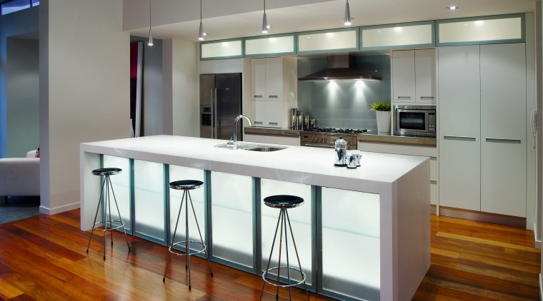 A view of this kitchen featuring polished timber cabinetry, countertop, cuisine classique, interior design, kitchen, real estate, gray