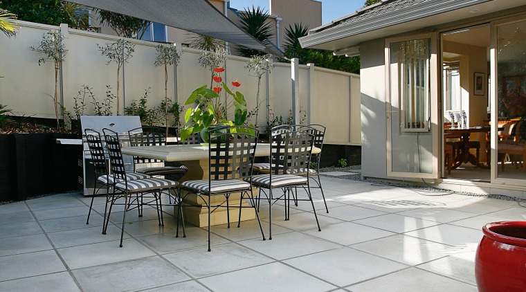 A view of the jagas platinum pavers layed apartment, architecture, backyard, courtyard, estate, house, outdoor structure, patio, real estate, residential area, roof, gray