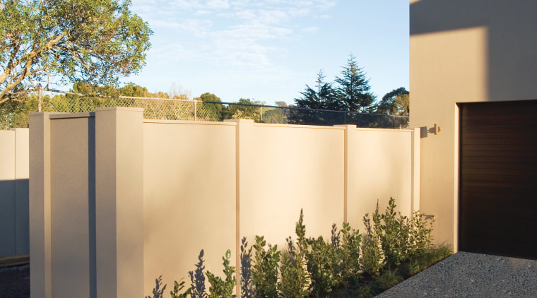 A view of the Panelrock modular wall system architecture, courtyard, estate, facade, fence, home, house, property, real estate, residential area, wall, yard