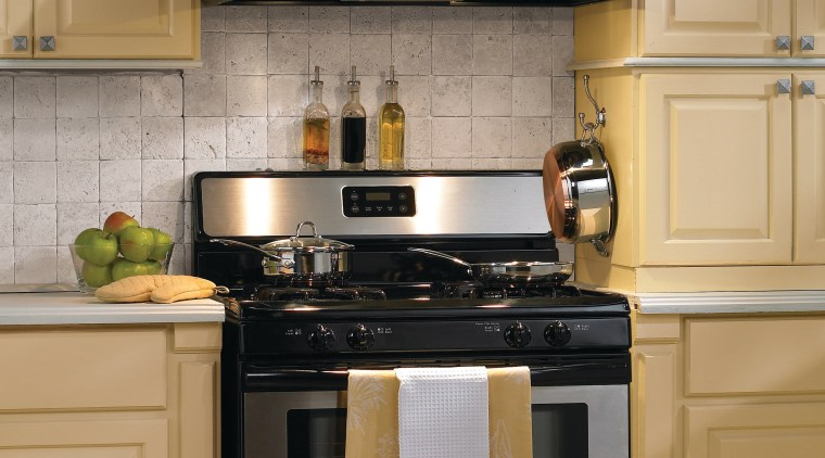 A view of a ventialtion system from Vent-A-Hood. cabinetry, countertop, cuisine classique, furniture, gas stove, home appliance, kitchen, kitchen appliance, kitchen stove, major appliance, oven, small appliance, orange, brown