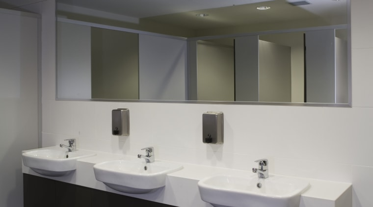 A view of the interior and exterior tiling, architecture, bathroom, bathroom accessory, ceiling, daylighting, floor, glass, interior design, product design, public toilet, sink, gray, black