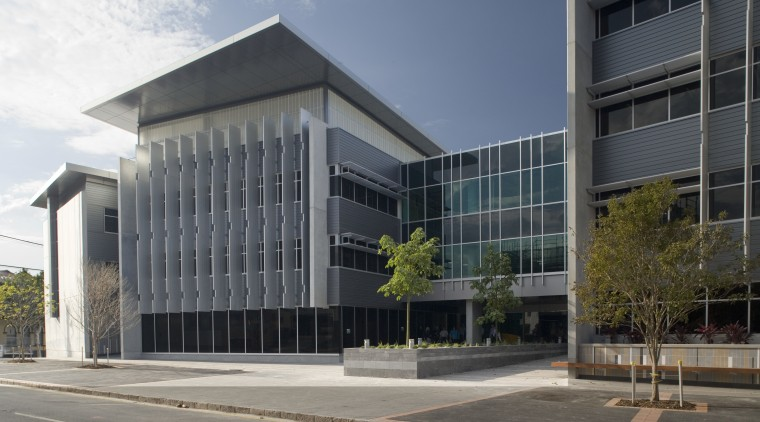An exterior view of the greensquare building. Butler architecture, building, commercial building, condominium, corporate headquarters, facade, headquarters, mixed use, property, real estate, gray, black