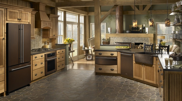 The richly hued Oiled Bronze collection of appliances cabinetry, countertop, cuisine classique, floor, flooring, hardwood, interior design, kitchen, laminate flooring, room, tile, wood flooring, brown