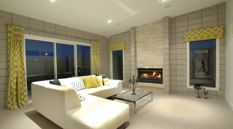 Even within the carefully considered showhome's decor, the ceiling, floor, interior design, living room, real estate, room, wall, orange, brown
