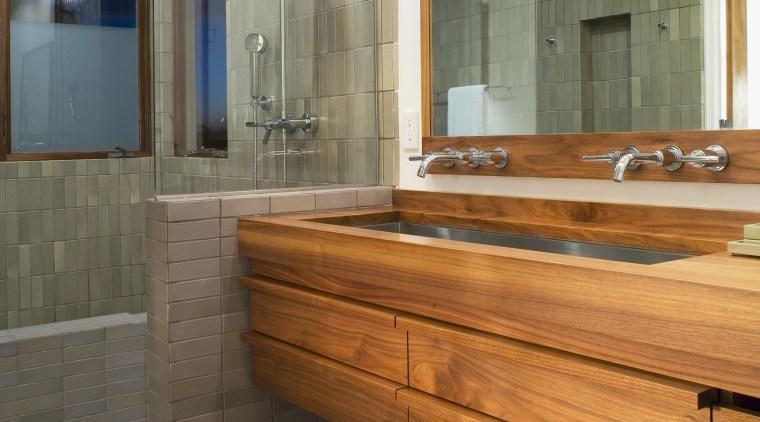 A view of a bathroom. bathroom, floor, flooring, interior design, room, gray, brown