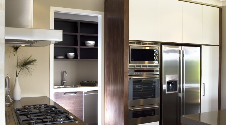 A view of some kitchen appliances from Electrolux. cabinetry, countertop, cuisine classique, home appliance, interior design, kitchen, white, brown