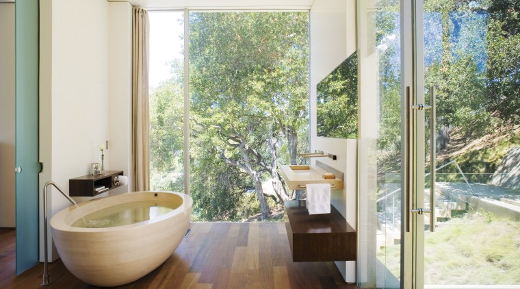 A view of the bathroom featuring oval limestone architecture, bathroom, estate, floor, home, house, interior design, property, real estate, room, window, white