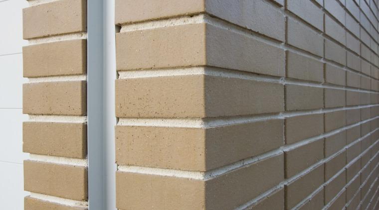 The bricks are Smoke Splits, part of CSR's brickwork, daylighting, facade, line, siding, wall, window, window blind, window covering, window treatment, wood, wood stain, gray