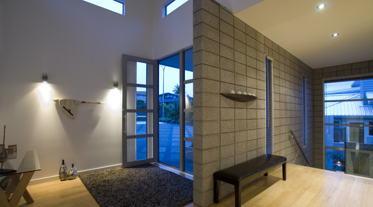 Honed concrete blcks from a feature wall for architecture, ceiling, home, interior design, real estate, room, wall, brown, gray