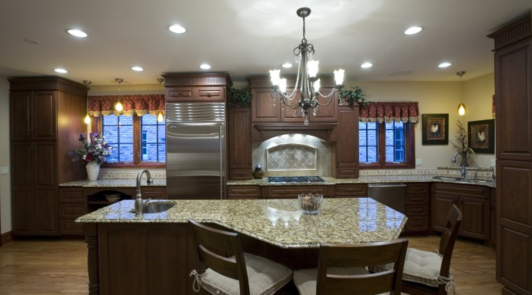 A view of this remodelled kitchen designed by cabinetry, ceiling, countertop, cuisine classique, dining room, estate, home, interior design, kitchen, room, gray, brown