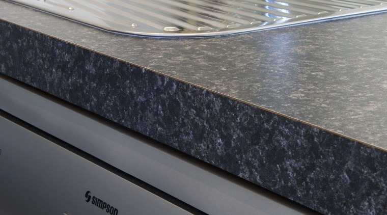 The Simpson range of appliances is desgined to countertop, kitchen, kitchen stove, sink, gray, black