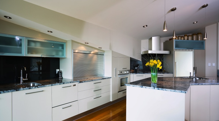 A view of this kitchen featuring the latest cabinetry, countertop, cuisine classique, interior design, kitchen, real estate, room, gray