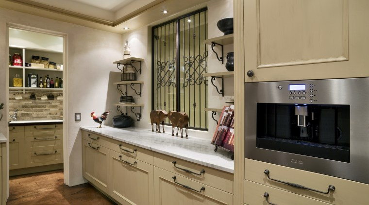 A view of some kitchen appliances from De'Longhi. cabinetry, countertop, cuisine classique, home appliance, interior design, kitchen, room, brown