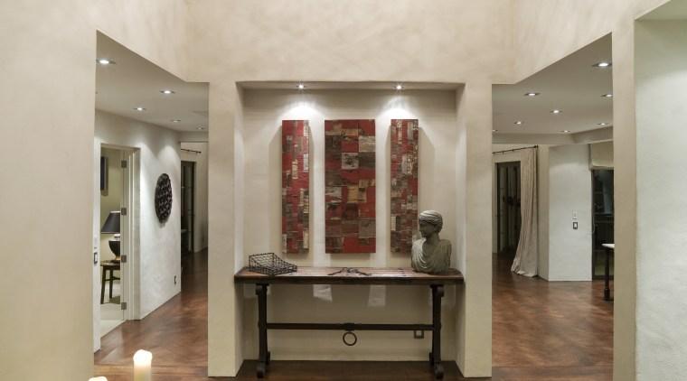 A view of a home designed by ceiling, estate, floor, flooring, hardwood, interior design, laminate flooring, living room, lobby, tile, wood flooring, brown, gray