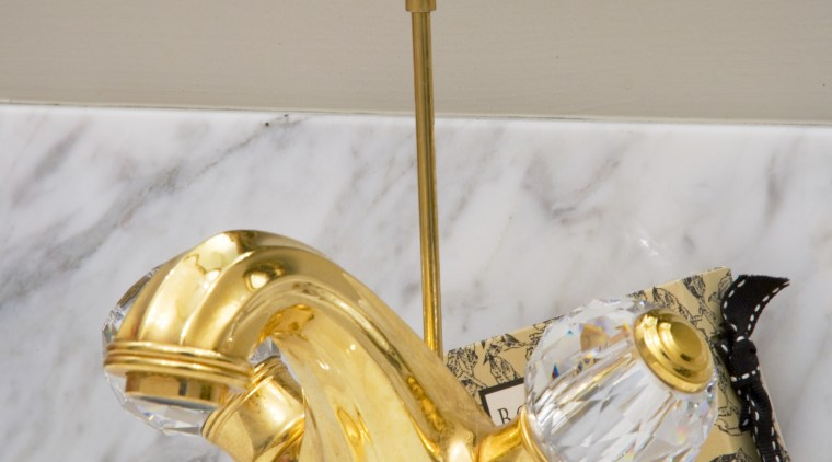 The luxurious theme is continued with the ornate brass, gold, material, metal, gray