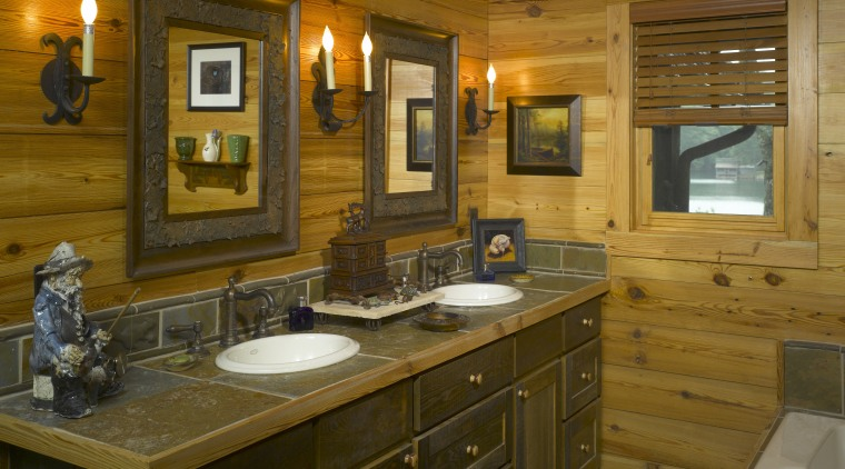 A wood vanity and tiled surface iterate the bathroom, cabinetry, countertop, interior design, kitchen, room, brown