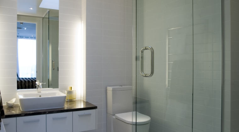 Simple, classic styling defines the apartment interiors. The architecture, bathroom, ceiling, daylighting, floor, glass, home, interior design, plumbing fixture, product design, room, gray