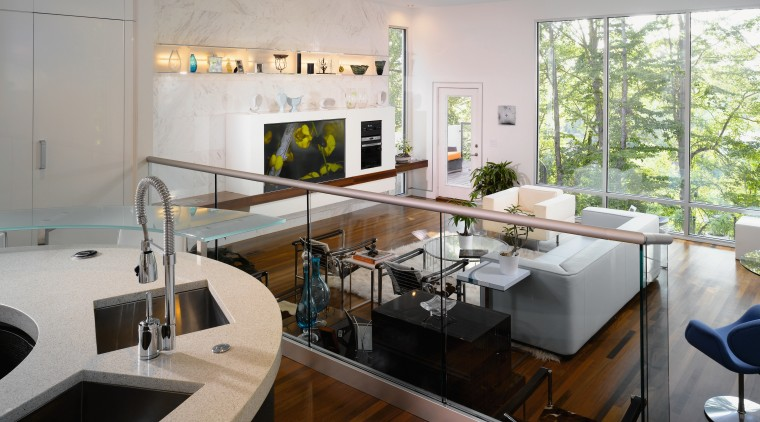 A view of the kitchen and living areas, countertop, interior design, kitchen, living room, gray
