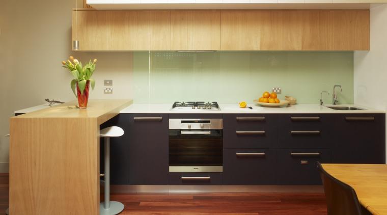 Kitchen designer Darren Grenner shares some suggestions for cabinetry, countertop, cuisine classique, floor, flooring, furniture, hardwood, interior design, kitchen, room, wood, wood flooring, brown